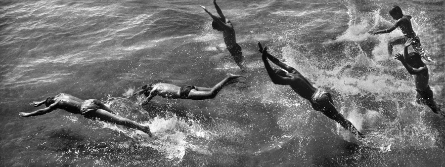 Boys diving into surf, 1954