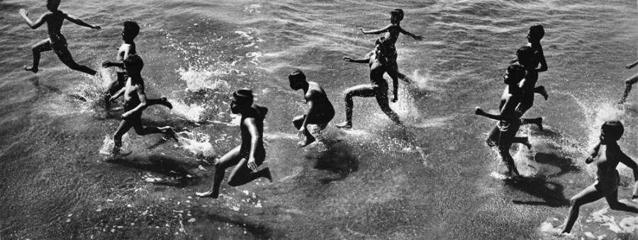 Boys running into surf, 1954