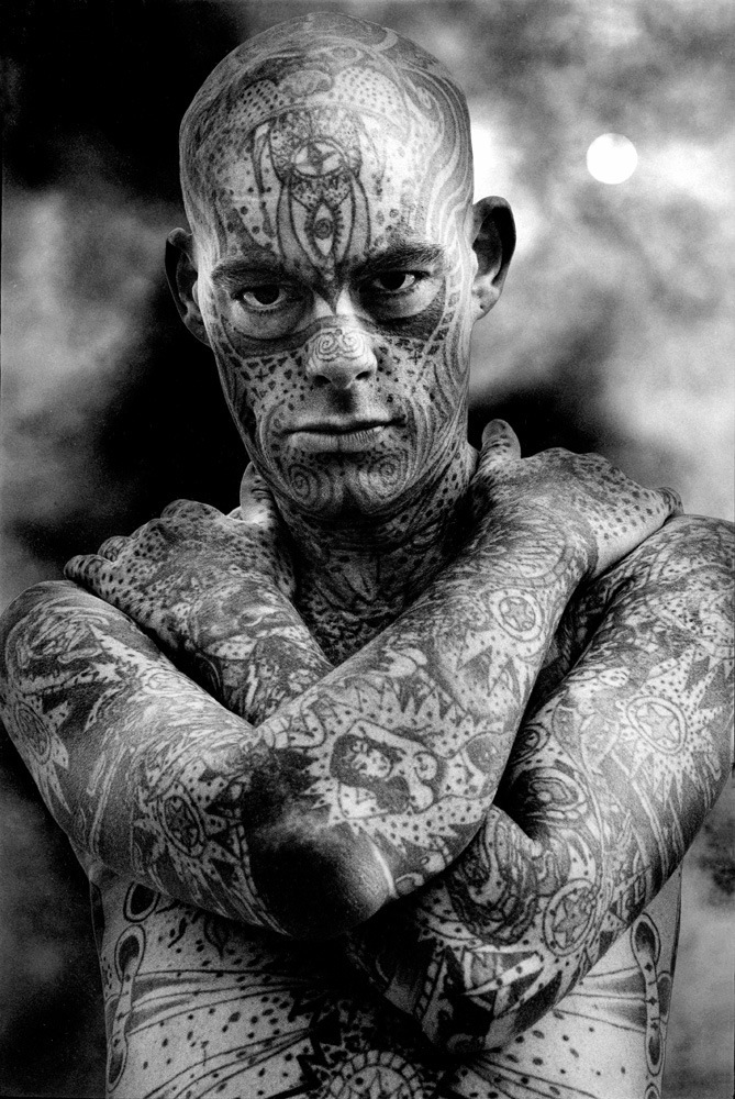 Tattooed Man Michael Wilson, 1992, © Harold Feinstein. Michael was a sideshow performer for 10 tens years before he died in 1996.