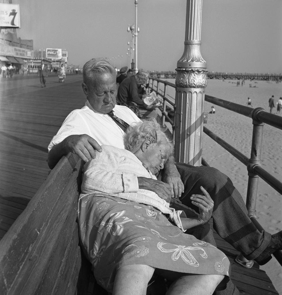Asleep on boardwalk bench, 1947