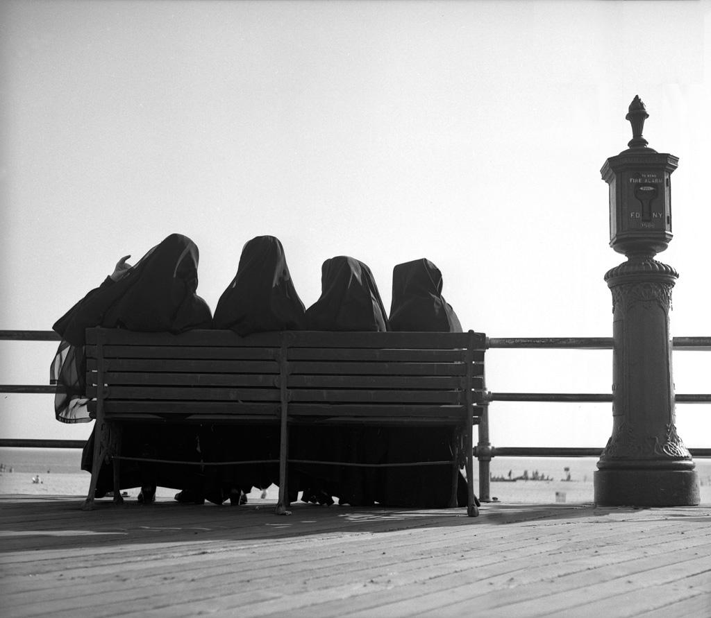 Nuns in habits on boardwalk, 1949