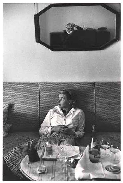 Ingrid Bergman on sofa with David Seymour, 1956