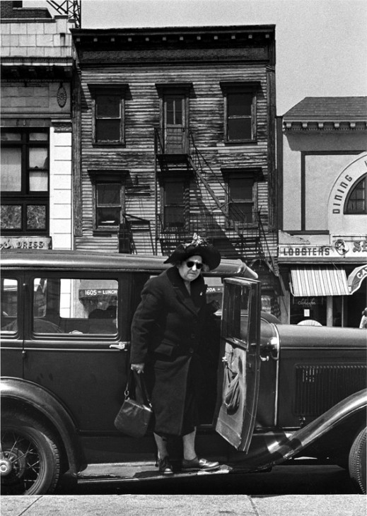 Woman stepping from car, 1948