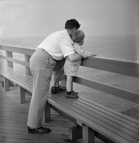 Father and Son at boardwalk rail, 1948