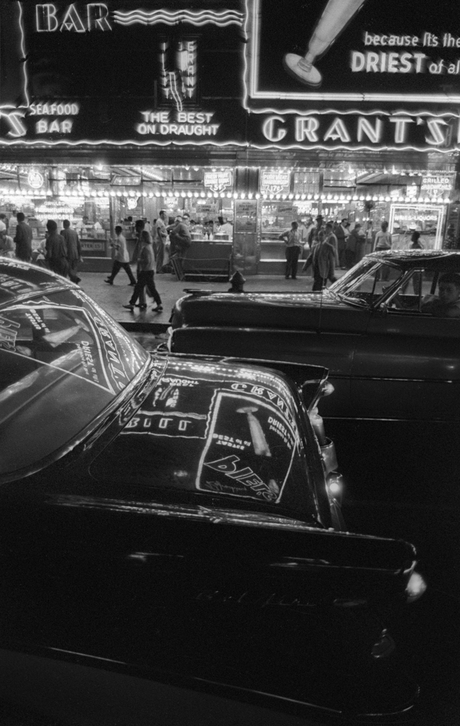 Times Square Saturday night, 1957  Here Grant's cafeteria is shown across the street and reflected on the car