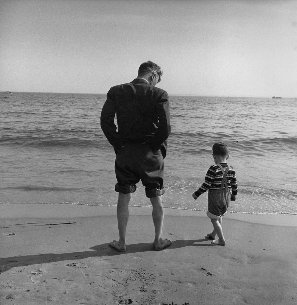 Father and son by waters edge, Coney Island, 1948