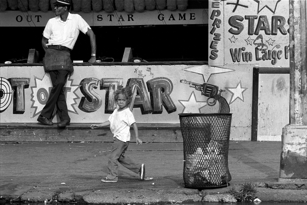 Child by shooting gallery, 1980