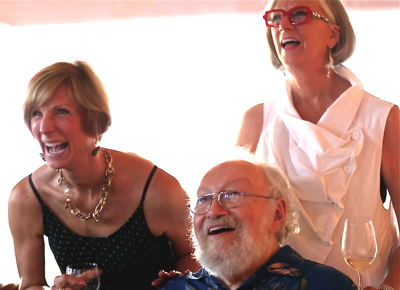 Harold enjoys the video with sisters-in-law Ruth Thompson from Carmel and Beth Black from Orlando