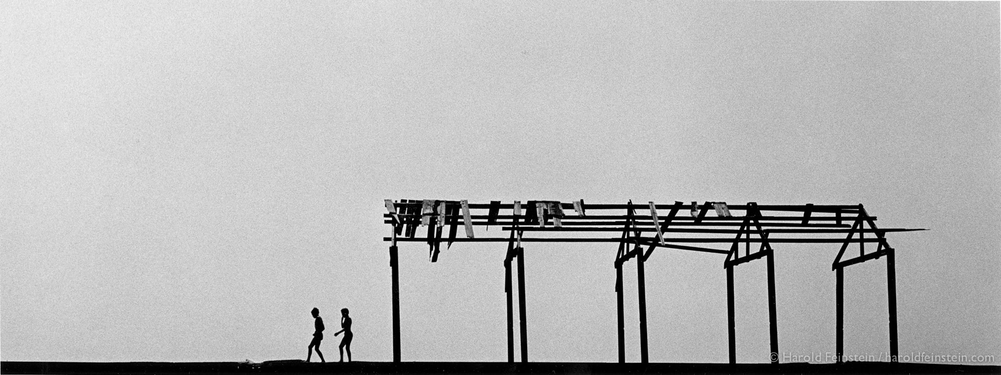 Two boys on pier, 1950, the first print I ever sold was purchased by Edward Steichen for the Mumseum of Modern Art. I was nineteen