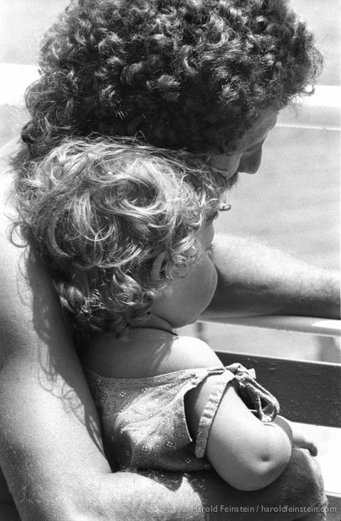 Curly haired daughter with dad, Greece, 1988