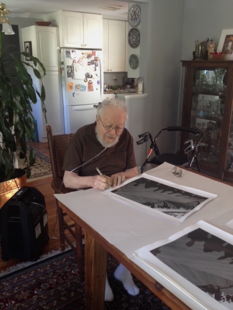 Harold signing prints, June 19, 2015