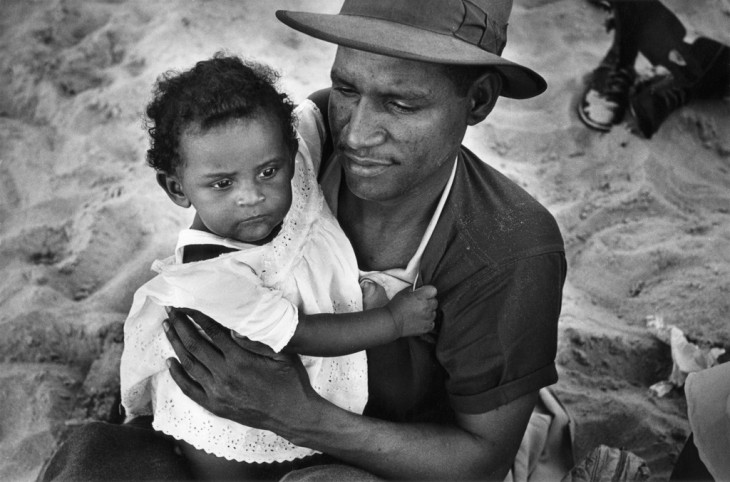 Haitian man with daughter, Coney Island, 1950