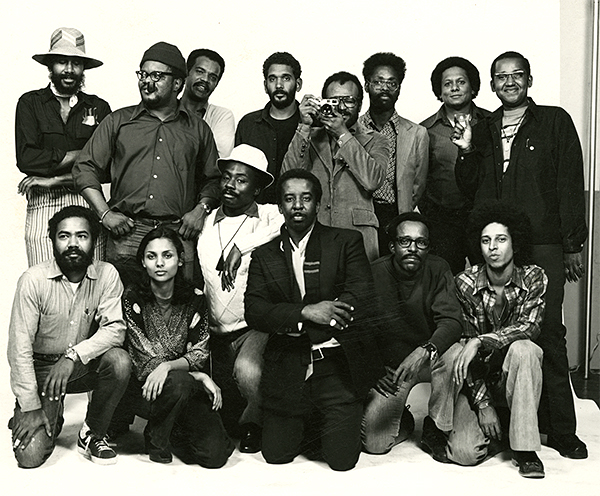 Kamoinge Workshop group photo, NYC, 1974. Draper front row and center. The Louis H. Draper Preservation Trust.