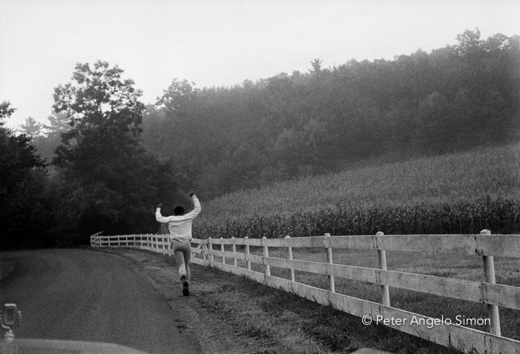 Ali's daily five mile training run began at dawn. There was no one around as he jogged through the Pennsylvania farm country. In the middle of nowhere he gave a victory salute.  I feel certain he gave himself such triumphal salutes when there was no one around to record them. © Peter Angelo Simon