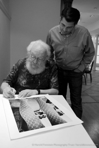 Photo: Harold Feinstein signs prints as Jason Landry watches on. title=